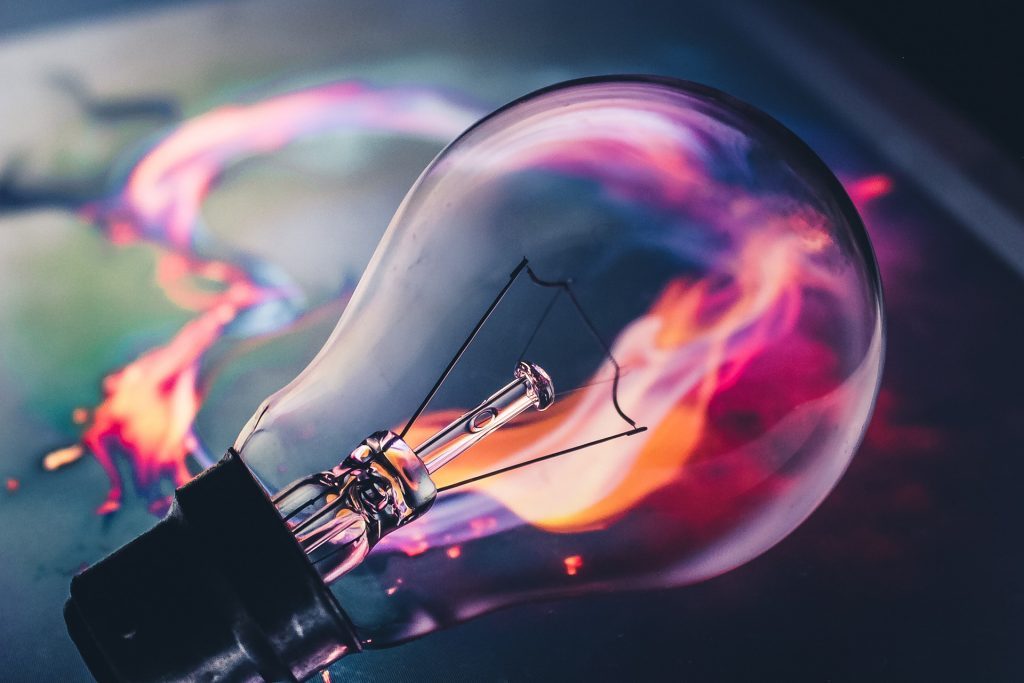 bulb with a pink-purple flame inside it